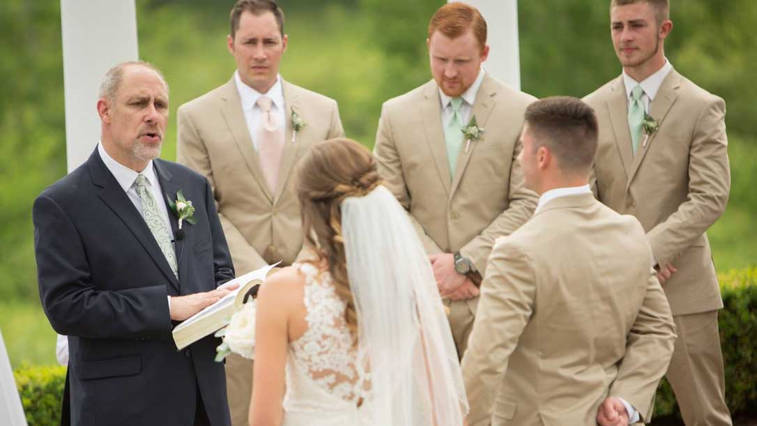 Scott lake Baptist Church Pastor, Jon Knapp officiating wedding ceremony